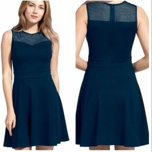 Blue sleeveless dress with mess top